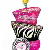 Striped Birthday Cake Display with Foils and pink latex